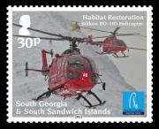 The 30p stamp shows all three of the helicopters used in Phase Two of the project in the air together. Based on a photograph taken by Oli Prince.