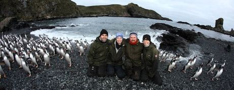 The Bird Islanders' midwinter photo was taken on Johnson Cove with returning gentoo penguins. Photo Mick