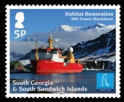 The 5p stamp features the support vessel RRS Shackleton. Based on a photo by Paul Wilkinson.