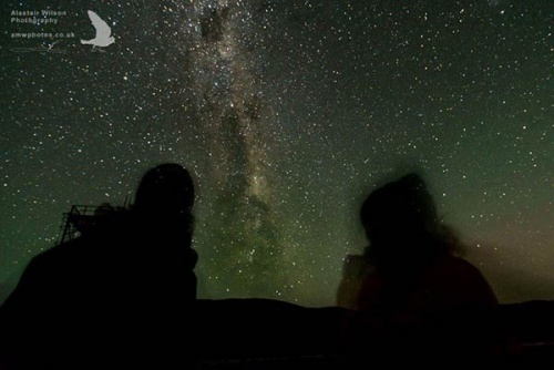 Base personnel appreciating a clear and starry night. Photo by Alastair Wilson.