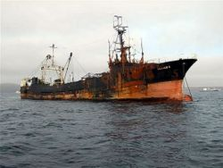 "The burnt out Korean trawler ""Ocean 8"" before she sank. Photo Stephen Luxton."