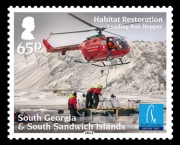 The 65p stamp shows filling of the bait bucket from a forward operating base in wintery weather during Phase Two.