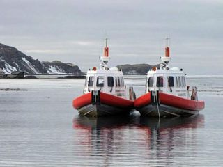 The two harbour launches anchored off Husvik.