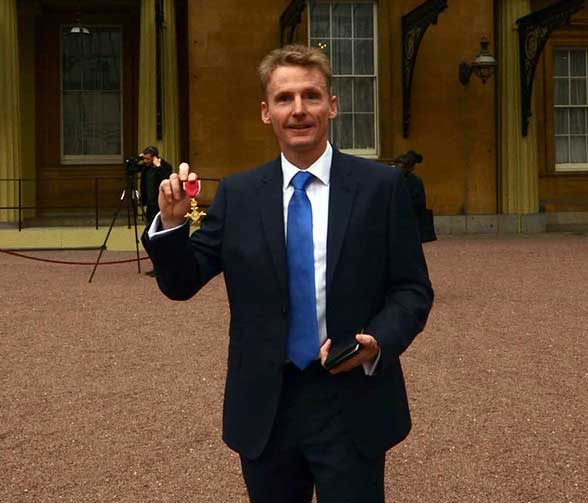 Martin Collins with his OBE following the investiture at Buckingham Palace