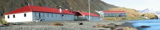The science base at KEP when it was newly built, the old base, Shackleton House, in the background (now demolished).