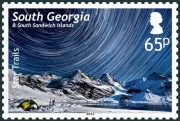 The 65p stamp shows star trails over the Harker Glacier.