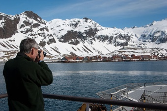 The Commissioner photographs Stromness whaling station.
