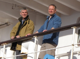 "Commissioner Nigel Haywood and Executive Officer Richard McKee aboard the FPV ""Pharos SG""."
