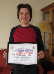 Ella du Breuil with the certificate she received with her commendation.