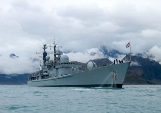 """HMS Gloucester anchors off Hope Point. Photo Sam Crimmin."