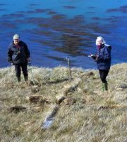 Bob and Jackie Burton using a metal detector to investigate the remains of 'Hudson's Beacons'. Photo Patrick Lurcock.