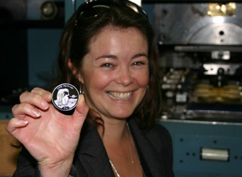Dr. Elizabeth White, one of the Directors of 'Frozen Planet', visited Pobjoy Mint to strike the first coin. Photo Pobjoy