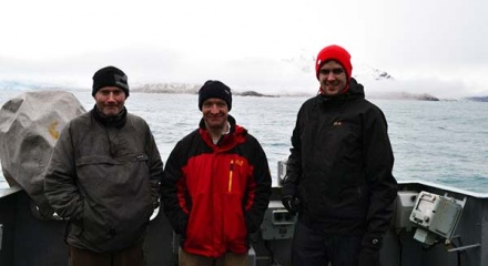 Richard McKee (centre) aboard HMS Argyll during his recent visit to South Georgia. Photo HMS Argyll.