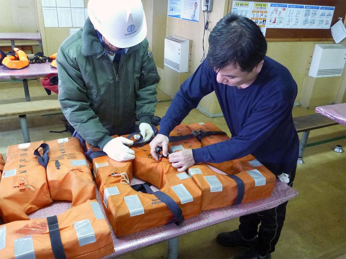 Checking lifejackets aboard a Krill Trawler.